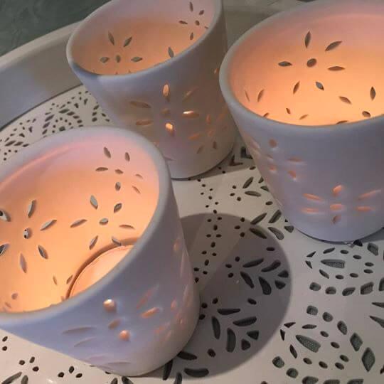 Porcelain Tea-Light Holders with Flower Cut Out Lit